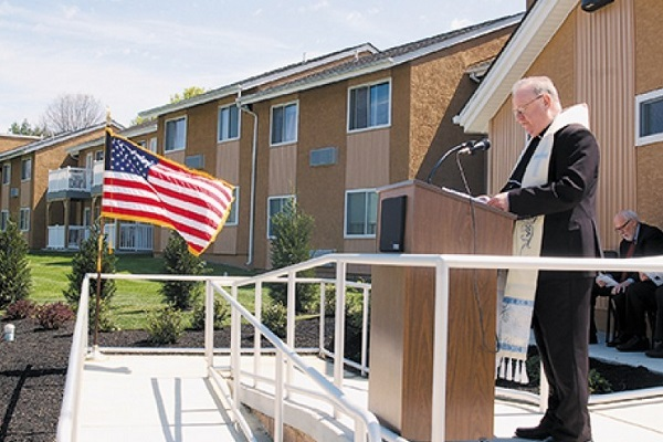 Village Apts rededication