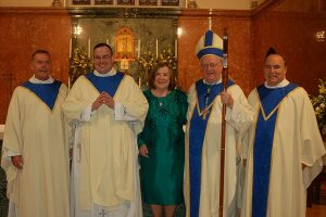 Kennedy Ordination with Bishop and family 600