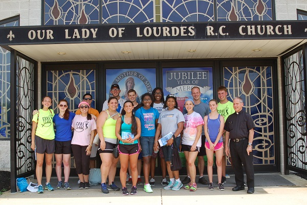 Our Lady of Lourdes Holy Door and united pilgrims web