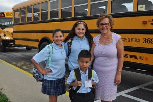 st-mary-williamstown-students-and-principal-in-front-of-bus-web